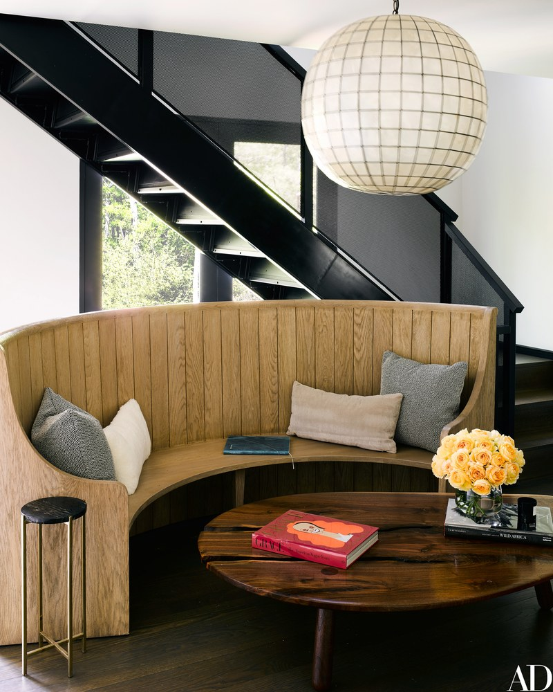 Decor Inspiration: Curved wood settee in Ellen Pompeo's Modern Barn Home in Sag Harbor, NY